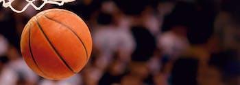 basketball flying in the air near hoop