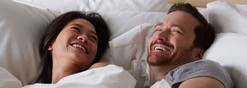 couple lying in queen size bed
