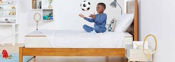 image of child on twin size mattress