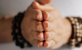 sleep habits around world - image of woman praying