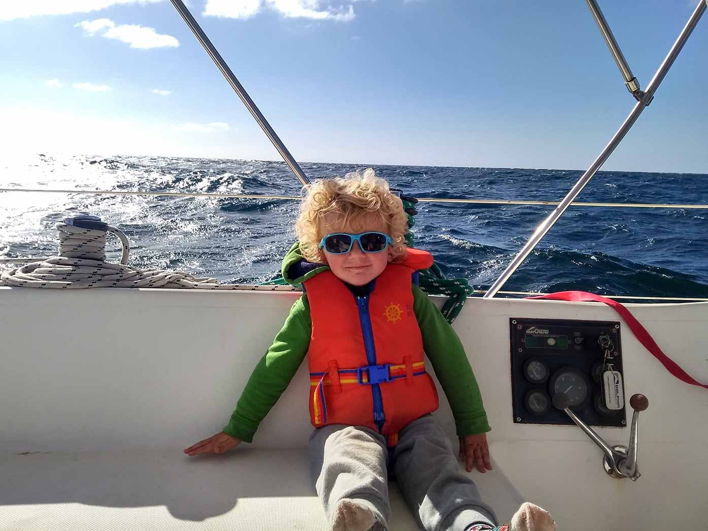 sleeping on a boat- image of little boy on boat