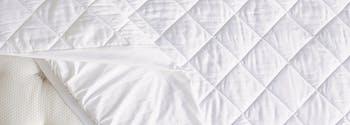 image of saatva dreams organic cotton mattress pad