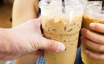 image of teens holding iced coffee