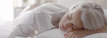 image of woman sleeping - how to break in a mattress