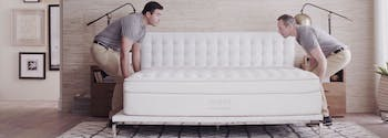 saatva delivery people setting up mattress