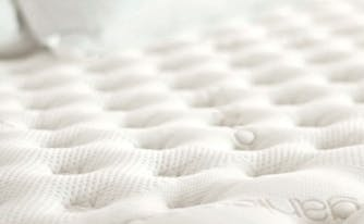 mattress firmness scale - image of saatva mattress