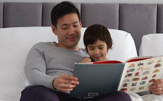 Person reading story to child