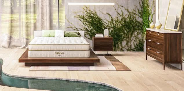 japandi style bedroom with mattress, plants, and wood furniture