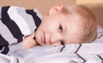 image of sleepy child in bed