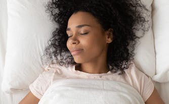image of person sleeping on back