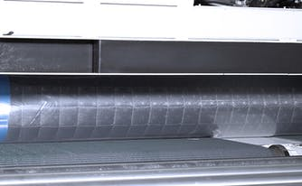 image of innerspring mattress being compressed