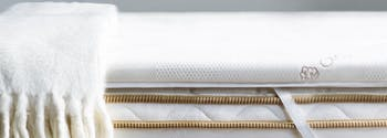 best mattress topper for back pain - image of saatva latex mattress topper