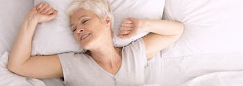 best latex mattress for back sleepers - image of woman sleeping on back