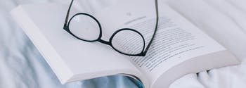 how reading in bed helps sleep - image of book in bed