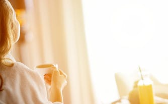 image of woman sitting in hotel room