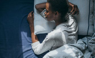 nighttime activities to help you relax - image of woman in bed