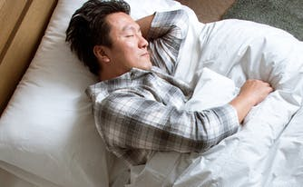 image of man sleeping - best mattress for side sleepers