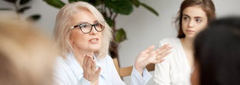 boost your career by getting better sleep - image of professional woman at work