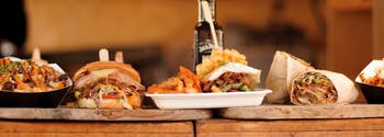 best and worst foods for sleep - image of hamburgers, fries, and whiskey