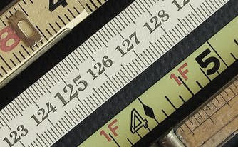 bunch of rulers to use to measure mattress sizes