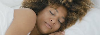 person sleeping in bed after reciting night affirmations
