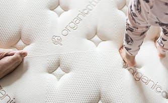 image of a child standing on a mattress - what is an organic mattress?