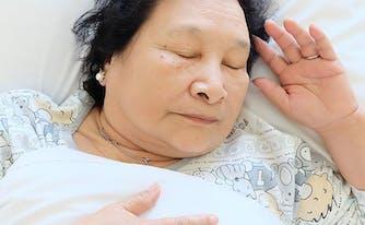 image of woman lying on back - best memory foam mattress for back sleepers