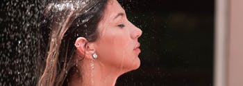 image of woman showering before bed