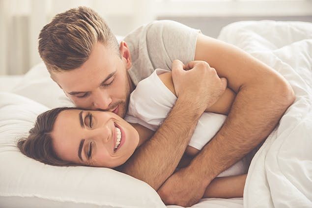 image of couple in bed snuggling
