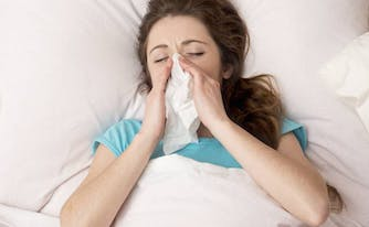 image of person with allergies in bed