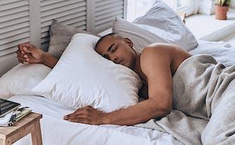 saatva classic innerspring mattress featured in men's journal - image of man sleeping in bed