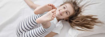 image of child with growing pains in bed