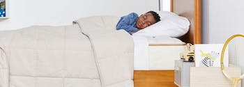 child sleeping in twin size bed