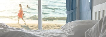 image of bed in summer rental
