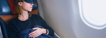 image of woman sleeping on airplane