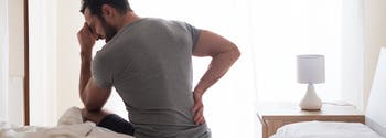 best mattress for back pain - image of person with back pain
