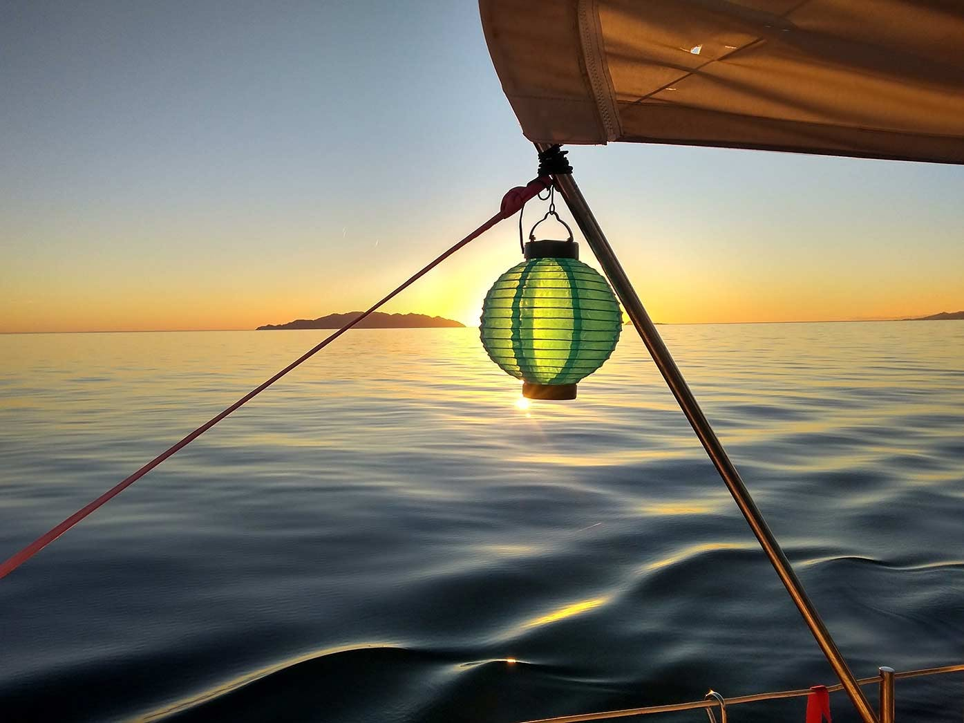 sleeping on a boat - image of sunset from boat