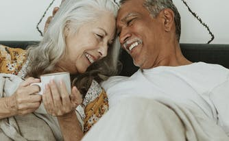 best mattress for elderly people - image of senior couple in bed