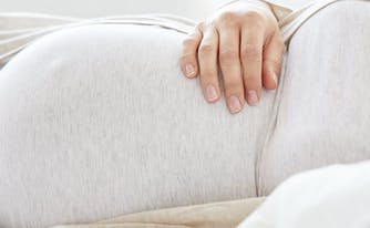 image of pregnant woman sleeping - best mattress for pregnancy