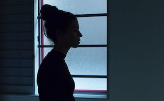 sleep habits of americans - image of woman standing in the dark