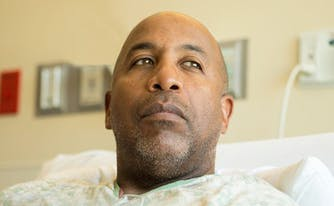 image of person with cancer in hospital bed