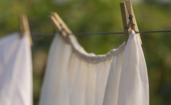 image of linens hanging out to dry