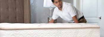 image of man moving a mattress