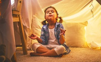 image of child meditating