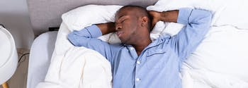 image of person sleeping on back in bed