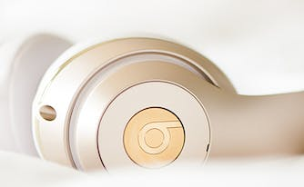best podcasts for sleep - image of headphones on bed