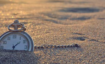 circadian rhythm - image of clock outside in sand