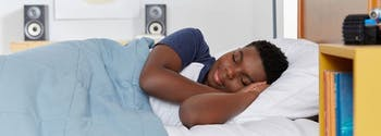best pillow for kids - image of child sleeping in bed