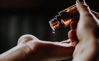 best essential oils to help sleep - image of essential oil in hand