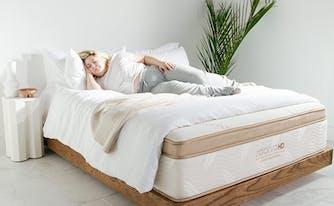 sleep tips for heavy people - image of woman lying on mattress